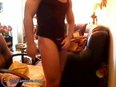 Muscular stud gets naked and strokes cock