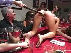 Busty chained babe toyed on table at dinner party