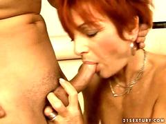 Old redhead sucking and riding young cock
