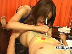 Lingerie clad Japanese artist paints and gives blowjob