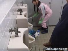 Asian bathroom attendant is in the mens film