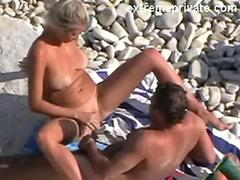 My 50 year old cheating gf and her lover on the beach