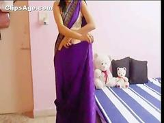 Indian lady showing off her navel again teaching how to wear saree