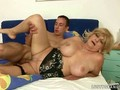Horny boy fucking a busty mature lady wearing sexy lingerie