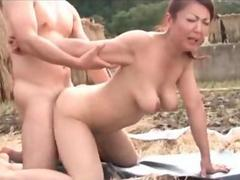 Big titted Japanese milf taking a doggy style fucking outdoors