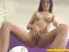 Pee fetish babe splashing her urine
