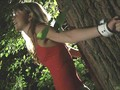 Skinny blonde slave gets tied by a tree in the forest