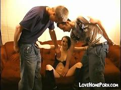 She strokes two cocks