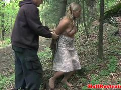 Closeup bdsm action outdoors and in a dungeon
