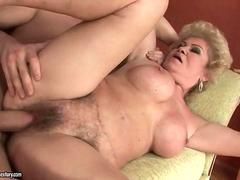 Hot busty granny enjoys hard sex with a boy