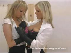 Busty blonde bombshells put on sexy leather gloves to caress their juicy big tits