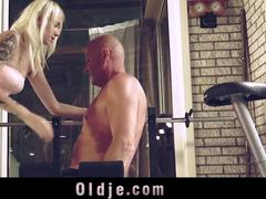 Bold girl seduces and fucks old man in a hotel gym room