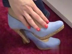 Hot femdom in pantyhose gives a mind blowing footjob