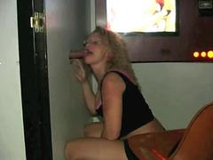 Curly blonde MILF with glasses sucking glory hole cock