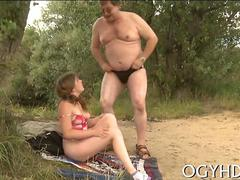 Petite teen gets fucked by fat old man on a lake beach