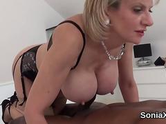 UK British MILF with big tits plays with black muscular guy