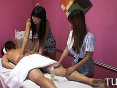 Two Asian massage babes fucking a white guy