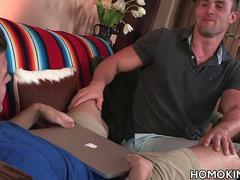 Muscular gay couple in a romantic gay sex scene