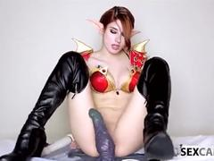 Sexy cosplay bloodelf takes huge black dildo in her snatch
