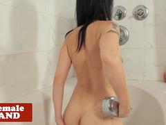 Showering shemale stroking her cock in tub