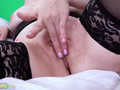 A granny wearing sexy lingerie stripping down on a webcam and masturbate