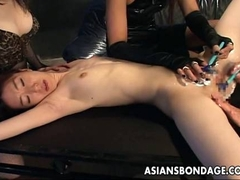 Asian babes hold the slut down so she gets pussy shaven