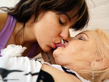 Hot brunette licking out a chubby granny