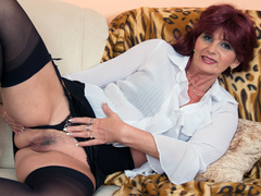 Horny granny pleasuring herself