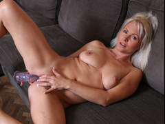 Sexy mom Kathy Anderson playing with a plastic cock