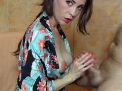 Sylvia Sucker uses her tits and hand to make her man cum