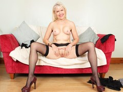 Blonde European granny fingering her pussy in stockings
